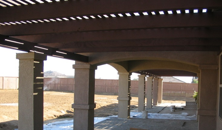 Patio Pop Out Arched With Tile Roof And Lattice Covers On Both Sides