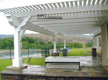 Wood Beam Style Lattice Patio Cover with Stone Columns and Built In BBQ Island